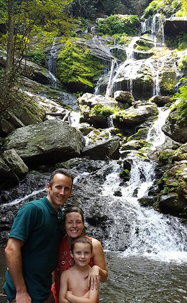 technician John Nanoski with family at waterfall